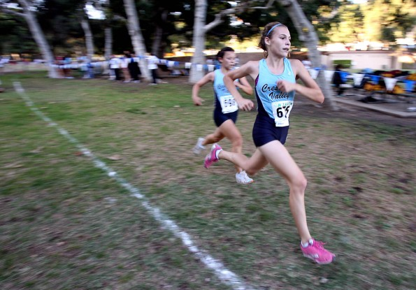 Crescenta Valley High School's Brooke Moultrie, front, puts on the afterburners and passes teammate Claudia Pham in the last few yards of the Pacific League cross country girls varsity meet at Crescenta Valley Park on Thursday, October 15, 2009.  (Raul Roa/News-Press)